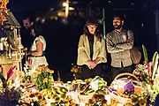 People gather around the gravesite of a family member during the Day of the Dead festival October 31, 2017 in Tzintzuntzan, Michoacan, Mexico.