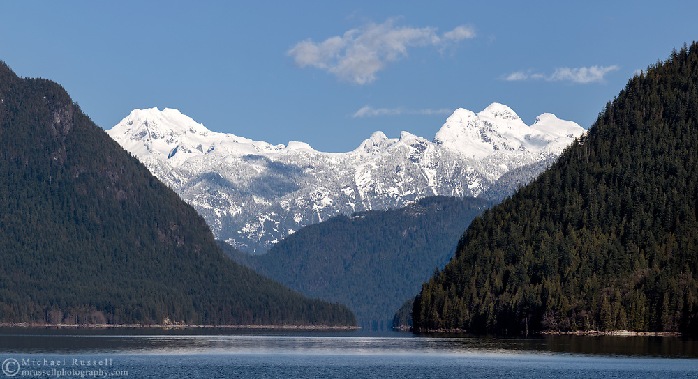 Mount Clark, Mount Breier and Stonerabbit Peak (L to R) as seen from Alouette Lake.  Photographed from South Beach on Alouette Lake in Golden Ears Provincial Park, Maple Ridge, British Columbia, Canada