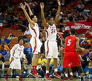 Trey Hall (4) and Rick Curry (24) of South Grand Prairie defend against Andrew Harrison (5) of Fort Bend Travis during the UIL 5A state championship game at the Frank Erwin Center in Austin on Saturday, March 9, 2013. (Cooper Neill/The Dallas Morning News)