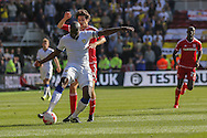 Leeds United defender Souleymane Bamba    shields the ball from Middlesbrough forward, on loan from Watford, Diego Fabbrini during the Sky Bet Championship match between Middlesbrough and Leeds United at the Riverside Stadium, Middlesbrough, England on 27 September 2015. Photo by Simon Davies.