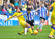 Leeds United Defender Giuseppe Bellusci tackles Sheffield Wednesday Forward Fernando Forestieri during the Sky Bet Championship match between Sheffield Wednesday and Leeds United at Hillsborough, Sheffield, England on 16 January 2016. Photo by Adam Rivers.
