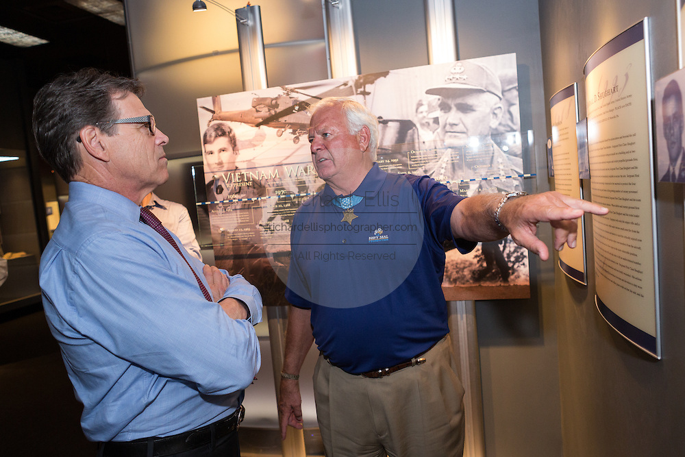 Former Texas Governor and GOP presidential hopeful Rick Perry takes a tour of the Medal of Honor museum with Medal recipient Mike Thornton before holding a town hall aboard the USS Yorktown in Mount Pleasant, South Carolina.