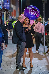 © Licensed to London News Pictures. 25/09/2020. Oxford, UK. A man and a woman stand on Cowley Road in Oxford after Thames Valley Police officers dispersed a small group of people after bars closed at 10pm as new restrictions brought in to curb increasing cases of the COVID-19 coronavirus take effect. Photo credit: Peter Manning/LNP