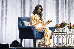 Former US first lady Michelle Obama speaks on stage at Accor Hotel Arena in Paris on April 16, 2019 during a tour to promote her memoir Becoming. Photo by Eliot Blondet/ABACAPRESS.COM