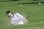 08 April 2009:   Ryo Ishikawa plays a practice shot from the green side bunker on hole #2. The final practice round of the 2009 Masters. Players play multiple balls from many different angles in an attempt to master possible reads for tournament days.