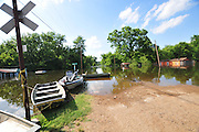 "8/13/11} Vicksburg} -- Vicksburg, MS, U.S.A<br />  --Robert Shiers aka Peanut paddles past his hand built cabin in the woods too check on the flood waters Friday May 13,2011 Peanuts flooded cabin on Chickasaw Road was a cabin in the woods is now a cabin on the flooded Mississippi River.  Hope and faith float as the Mississippi River continues to rise around the Kings Community on Friday the 13th of May 2011. ""Peanut "" aka Robert Shiers navigates his ""John Boat"" down Chickasaw Rd. in Vicksburg Mississippi. His hand built ,self designed cabin which sits on 14ft. stilts on the old Belle Meade Plantation was on a 5acre wheat field that is now inundated with water and only able to get to by boat.  No mail today for residents of the Kings Community in Vicksburg MS Friday May 13, 2011.The Mississippi River in Vicksburg, Mississippi is expected to crest at a record 58.5 feet. The water is moving at 2.2million cubic feet per second, to put it in perspective it would fill the SuperDome in New Orleans in 30 seconds. Pictured is the historic Yazoo Valley Railroad Station in downtown Vicksburg. The River is flooding over 1.2 million acres of farm land and damaging thousands of homes and disrupting thousands of peoples lives. Vicksburg a riverfront town steeped in war and sacrifice, gets set to battle an age-old companion: the Mississippi River. The city that fell to Ulysses S. Grant and the Union Army after a painful siege in 1863 is marshaling a modern flood-control arsenal to keep the swollen Mississippi from overwhelming its defenses. PHOTO©SUZI ALTMAN.COM<br /> Photo by Suzi Altman"