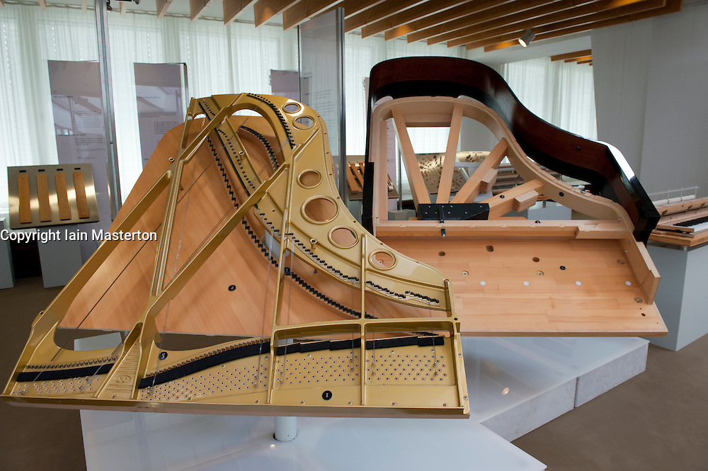 Display of modern piano manufacturing at Musikinstrumenten Museum or Museum of Musical Instruments in Mitte Berlin Germany