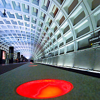 Abstract view of Washington DC's rapid transit underground train station platform showing colored warning light that platform level ends.