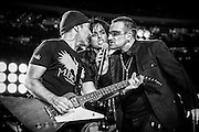 """The Edge of U2, Billie Joe Armstrong of Green Day and Bono of U2 perform """"The Saints Are Coming"""" in a pre-game concert with Green Day prior to the Monday Night Football game between the Atlanta Falcons and New Orleans Saints as part of the re-opening of the Superdome in New Orleans, Louisiana on September 25, 2006."""