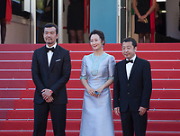 Actor Fan Liao, actress Tao Zhao and director Zhangke Jia at the Ash Is The Purest White (Jiang Hu Er Nv) gala screening at the 71st Cannes Film Festival, Friday 11th May 2018, Cannes, France. Photo credit: Doreen Kennedy