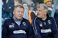 Wimbledon Manager Wally Downes and Glyn Hodges Wimbledon First Team Assistant Manager during the EFL Sky Bet League 1 match between Scunthorpe United and AFC Wimbledon at Glanford Park, Scunthorpe, England on 30 March 2019.