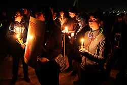 November 16, 2018 - Eloy, Arizona, USA - Candlelight vigil at the Eloy Detention Center in Eloy, Arizona. Eloy is a private prison owned and operated by CoreCivic under a contract with US Immigration and Customs Enforcement. Illegal immigrants are held at the facility while they await a hearing before a judge . The protest was organized by the Puente Human Rights movement to highlight conditions at the prison and the illegal incarceration of detainees. Supporters called for the abolishment of I.C.E and rights of migrants. (Credit Image: © Christopher Brown/ZUMA Wire)