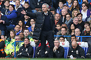 Jose Mourinho, the Manchester United manager looks on from the dugout. Premier league match, Chelsea v Manchester Utd at Stamford Bridge in London on Sunday 23rd October 2016.<br /> pic by John Patrick Fletcher, Andrew Orchard sports photography.