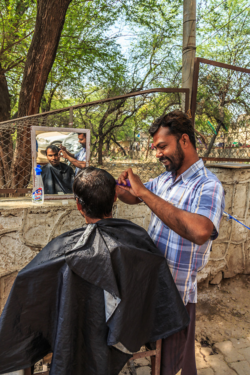 A street barber in New Delhi, India.