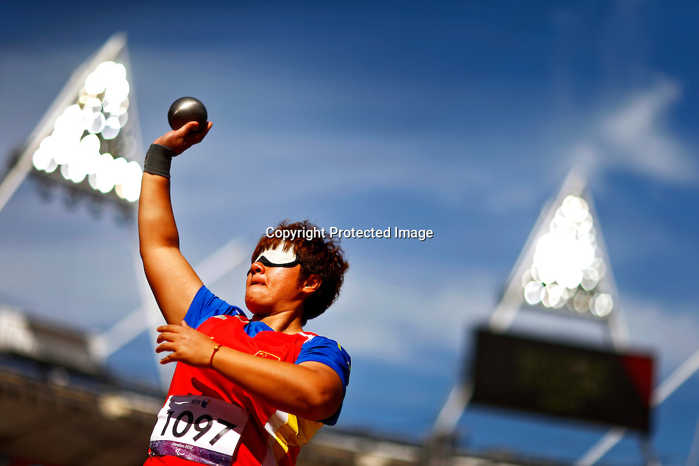 Zhang Liangmin of China competes in the women's Shot Put F11/12 final at the Olympic Stadium during the London 2012 Paralympic Games in London, Britain, 05 September 2012. Zhang Liangmin won the bronze medal.  EPA/KERIM OKTEN