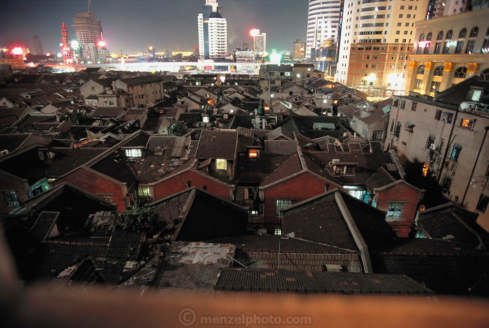 Old neighborhood and new encroaching construction. Shanghai, China.