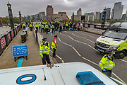 Metropolitan police closed Lambeth Bridge both ways (in picture North side) after Extinction Rebellion (Ride For Our Lives) a critical mass of cyclists rode in and chained themselves at the Bridge's railings on Thursday, Sept 3, 2020. The bridge remains closed by the police who also are not allowing members of the press to do their job. There are other Extinction Rebellion protests ongoing in London. Millbank is also blocked southbound from the bridge. Environmental non-violent activists group Extinction Rebellion enters its 3rd day of continuous ten days to disrupt political institutions throughout peaceful actions swarming central London into a standoff, demanding that central government obeys and delivers Climate Emergency bill. (VXP Photo/ Vudi Xhymshiti)