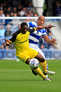 Burton Albion striker Marvin Sordell (17) controls the ball from Queens Park Rangers defender Alex John-Baptiste (20) during the EFL Sky Bet Championship match between Queens Park Rangers and Burton Albion at the Loftus Road Stadium, London, England on 23 September 2017. Photo by Richard Holmes.