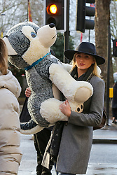 © Licensed to London News Pictures. 21/12/2019. London, UK. A Christmas shopper is seen with a large soft toy on London's Oxford Street. Retailers are expecting a rush of shoppers in the lead-up to Christmas. Photo credit: Dinendra Haria/LNP