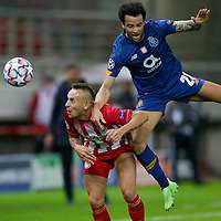 PIRAEUS, GREECE - DECEMBER 09: Felipe Anderson of FC Porto and Rafinha of Olympiacos FC during the UEFA Champions League Group C stage match between Olympiacos FC and FC Porto at Karaiskakis Stadium on December 9, 2020 in Piraeus, Greece. (Photo by MB Media)