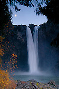 The moon rises over Snoqualmie Falls, a  268 foot (82 meter) waterfall located on the Snoqualmie River near Snoqualmie, Washington.