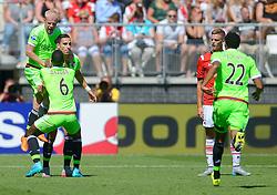 09-08-2015 NED: AZ - Ajax, Alkmaar<br /> Ajax verslaat AZ vrij eenvoudig met 3-0 / Anwar El Ghazi #21 scoort de 1-0 en viert dit ,et Davy Klaassen #10, Riechedly Bazoer #6. Rechts Markus Henriksen NOO #10, Jairo Riedewald #22