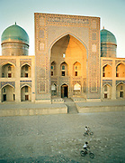 Mir-i-Arab Medressa, one of the most famous mosque in the the fabled city of Bukhara, on the ancient Silk Road. Uzbekistan.