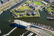 Nederland, Noord-Holland, Amsterdam, 09-04-2014;<br /> Marineterrein (boven), beneden ingang IJtunnel met museum Nemo, links Dijksgracht met spoorbaan.<br /> Navy area and the Museum Nemo and the entrance IJ-tunnel to Amsterdam North.<br /> luchtfoto (toeslag op standard tarieven);<br /> aerial photo (additional fee required);<br /> copyright foto/photo Siebe Swart