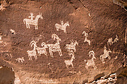 Ute Rock Art (1650-1850), on the trail to Delicate Arch, Wolfe Ranch, Arches National Park, Moab, Utah, USA. A thick underground salt bed underlies the creation of the park's many arches, spires, balanced rocks, sandstone fins, and eroded monoliths. Some 300 million years ago, a sea flowed into the area and eventually evaporated to create the salt bed up to thousands of feet thick. Over millions of years, the salt bed was covered with debris eroded from the Uncompahgre Uplift to the northeast. During the Early Jurassic (about 210 million years ago) desert conditions deposited the vast Navajo Sandstone. On top of that, about 140 million years ago, the Entrada Sandstone was deposited from stream and windblown sediments. Later, over 5000 feet (1500 m) of younger sediments were deposited and then mostly worn away, leaving the park's arches eroded mostly within the Entrada formation.