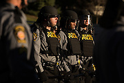 Pennsylvania State Police in riot gear protecting neo-Nazis from protesters at the Pennsylvania State Capitol.