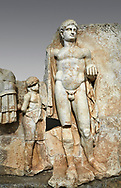 Close up of a Roman Sebasteion relief  sculpture of Emperor Nero with captive, Aphrodisias Museum, Aphrodisias, Turkey. <br /> <br /> Naked warrior emperor Nero holds the orb of world rule in one hand and crowns the military trophy with the other. Between the trophy and the emperor stands a bound captive boy. He wears long barbarian trousers and looks up at Nero. .<br /> <br /> If you prefer to buy from our ALAMY STOCK LIBRARY page at https://www.alamy.com/portfolio/paul-williams-funkystock/greco-roman-sculptures.html . Type -    Aphrodisias     - into LOWER SEARCH WITHIN GALLERY box - Refine search by adding a subject, place, background colour, museum etc.<br /> <br /> Visit our ROMAN WORLD PHOTO COLLECTIONS for more photos to download or buy as wall art prints https://funkystock.photoshelter.com/gallery-collection/The-Romans-Art-Artefacts-Antiquities-Historic-Sites-Pictures-Images/C0000r2uLJJo9_s0
