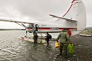 Ranger Tom Griffin, right, helps unload a de Havilland DHC-3 Otter seaplane after landing at the remote McNeil River Game Sanctuary in the Katmai Peninsula, Alaska. The float plane is the only way in and out of the remote location known for the highest concentration of brown bears in the world.