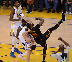 June 12, 2017 - Oakland, CA, USA - The Golden State Warriors' Draymond Green (23) catches teammate Klay Thompson (11) after he fouls the Cleveland Cavaliers' Tristan Thompson (13) in Game 5 of the NBA Finals at Oracle Arena in Oakland, Calif., on Monday, June 12, 2017. The Warriors won, 129-120, to clinch the series. (Credit Image: © Dan Honda/TNS via ZUMA Wire)