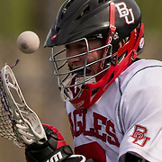 3/2/13 4:13:35 PM --- LACROSSE SPORTS SHOOTER ACADEMY 010 --- A lacross player from Biola University chases down a ball during the Biola University vs Fullerton, Lacross match Saturday afternoon March 2, 2013. Photo by Juan Antonio Labreche, Sports Shooter Academy