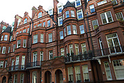 Red brick mansion buildings are part of the architecture in Belgravia London, United Kingdom. Belgravia is a district in West London in the City of Westminster and the Royal Borough of Kensington and Chelsea. It is noted for its very expensive residential properties and is one of the wealthiest districts in the world. Much of it, known as the Grosvenor Estate, is still owned by a family property company, the Duke of Westminsters Grosvenor Group.