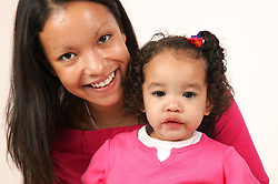 Smiling young mother holding her baby,