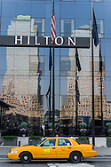 New York, lower Manhattan; the Hilton hotel , reflection on a mirror tower. , the two buildings of the world financial center reflecting on the front of the Hilton hotel downtown,/ la facade du Hilton  downtown, . , refllet des tours du World , financial center sur  quartier du world trade center