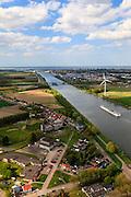 Nederland, Zeeland, Zeeuws-Vlaanderen, 09-05-2013; cruiseschip op Kanaal Gent-Terneuzen, ter hoogte van Sluiskil.  Gezien naar Terneuzen, Westerschelde aan de horizon. Draaibrug van de Hoofdweg (N61/62) over het kanaal. Links van het kanaal beneden voormalig zusterhuis Hotel Sluiskil,  op de nominatie om gesloopt te worden.<br /> Cruise ship on the Gent-Terneuzen canal in the south of the province Zeeland.  Westerschelde at the horizon.<br /> luchtfoto (toeslag op standard tarieven)<br /> aerial photo (additional fee required)<br /> copyright foto/photo Siebe Swart