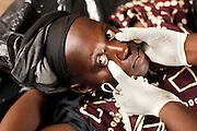 Nurse Maba N'Djim examines Awa Diarra, 26, 3 mo. pregnant, during a prenatal consultation in the village of Banankoro, Mali on Saturday August 28, 2010..