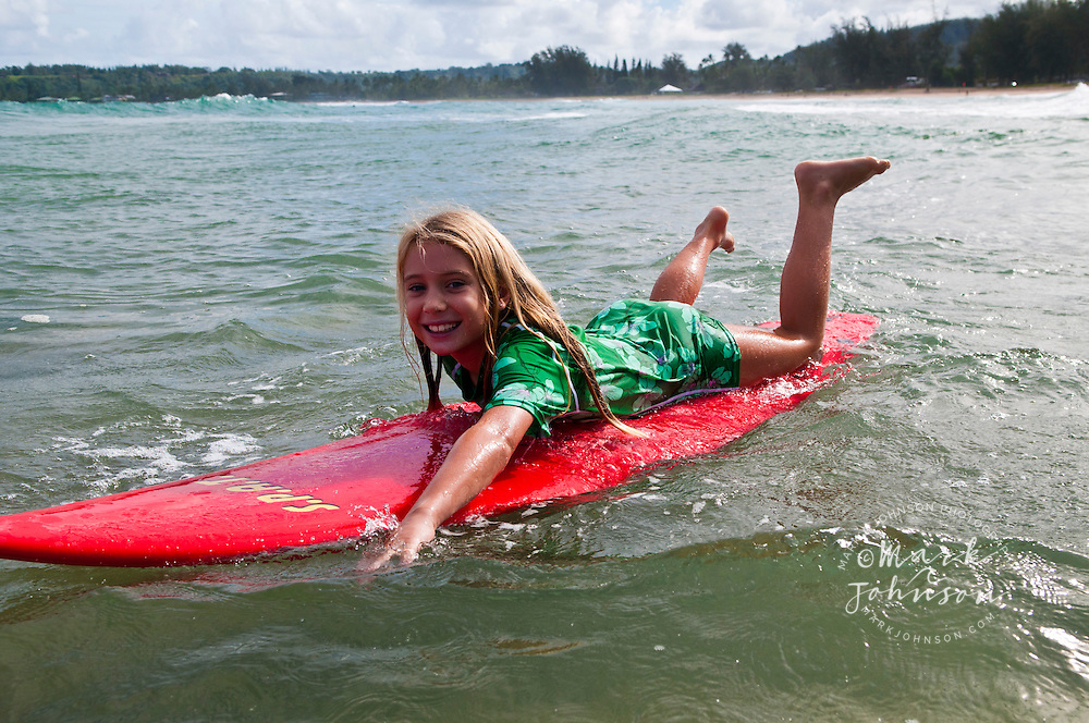 7 year old girl surfing at Hanalei Bay, Kauai, Hawaii people ****Model Release available ***Model Release available