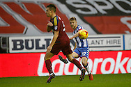 Wigan's Michael Jacobs (17) gets the cross in during the EFL Sky Bet Championship match between Wigan Athletic and Ipswich Town at the DW Stadium, Wigan, England on 17 December 2016. Photo by Craig Galloway.