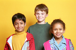 Multiracial group of children standing together smiling,