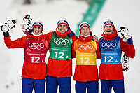 PYEONGCHANG,SOUTH KOREA,19.FEB.18 - OLYMPICS, NORDIC SKIING, SKI JUMPING - Olympic Winter Games PyeongChang 2018, team event, men, flower ceremony. Image shows the rejoicing of Daniel Andre Tande (NOR), Andreas Stjernen (NOR), Johann Andre Forfang (NOR), Robert Johansson (NOR). <br /> <br /> Norway only