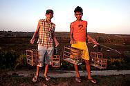 Boys with bird cages in Gibara, Holguin, Cuba.