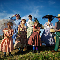 (L-R) Jones family children Gabriel, 7, Bernadette, 4, Elizabeth, 7, Bridget, 6, and Matthew, 9, from Donnelsville, Ohio, observe troops marching off the battlefield on the second of a four day Gettysburg Anniversary Committee 150th Gettysburg reenactment in Gettysburg, PA on July 5, 2013.