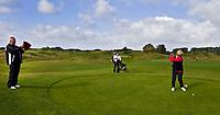 AMSTERDAM - Golfprofessional  Cees Renders van de NGF op pad met Margot Schellekens (rode trui) en Ilse Oltmann (rose jack) op de International.Golfbaan. De dames hadden een prijs gewonnen met NGF Fairwaystrokes. Tijdens de ronde maakte Cees opnamen met zijn iPad. FOTO KOEN SUYK