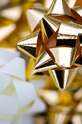 Extreme close up of gold bows
