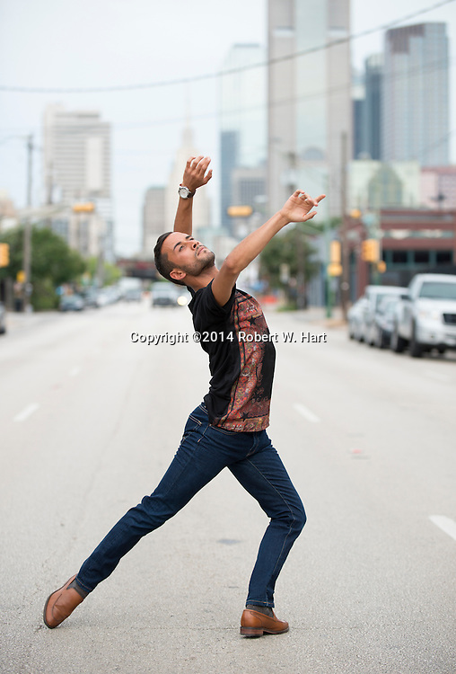 Choreographer Chadi El-Khoury dancing in on Commerce Street in the Deep Ellum neighborhood of Dallas.