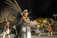 A dancer from Yaocuauhtli blesses waiting cars with copal in the intersection of Pacific and Garner in east Salinas. The ACFA Day of the Dead procession traced a route around the neighborhood.