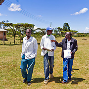 Pictured here walking with Moses Kigen (left) and Philemon Saina (right), Alex Sawe (centre) is in charge of the project development of a youth group based in the village of Katuiyo in Uasin Gishu County in Kenya's Rift Valley Province.